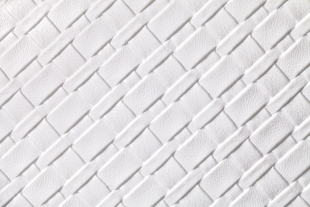 Texture of white leather textile background with wicker pattern, macro.