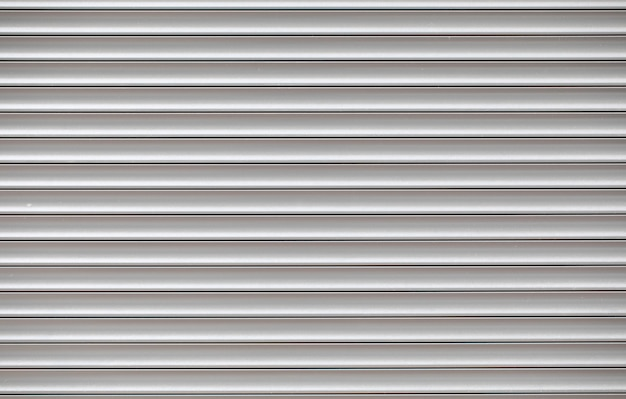 Texture of white metal shutter on shop door background