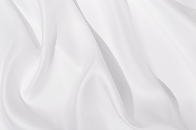 Texture of white silk cloth, textile background, drapery and pleats on delicate fabric
