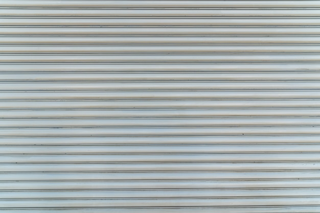 Texture of white steel roll door horizontal line.