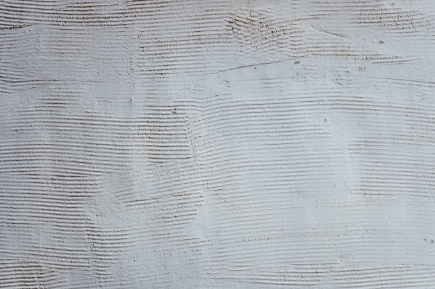 Texture of a white wall with grooves, empty background.