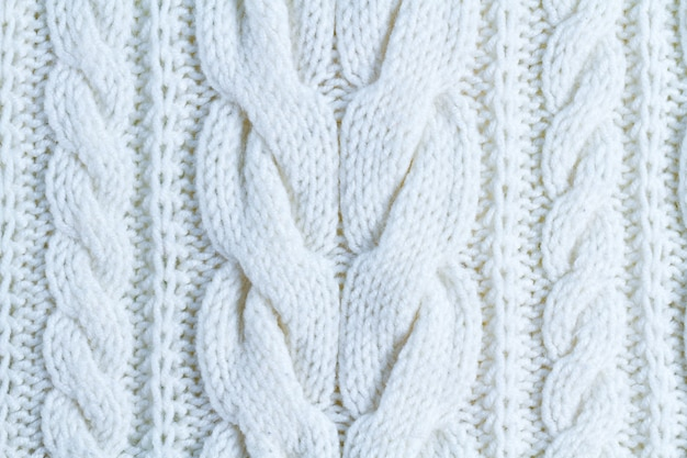 The texture of white yarn. knitted and winter clothes