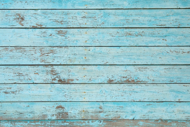 Texture wooden background with old cracked blue paint