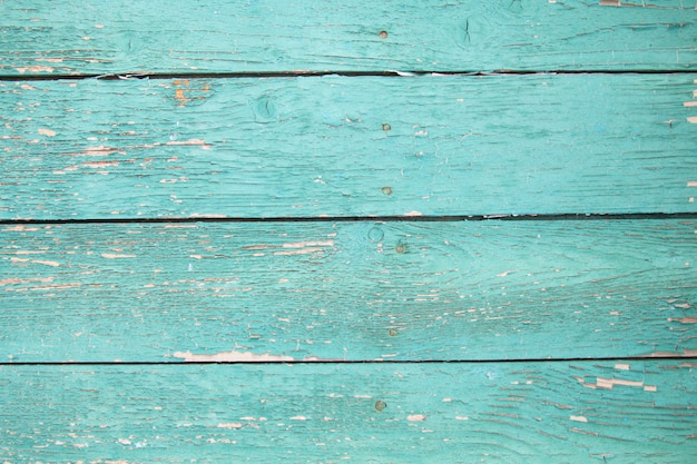 Texture wooden background with old cracked green paint