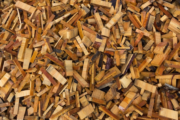 Texture. woodworking waste. heaps of chips, bark, pieces and sawdust.high quality photo