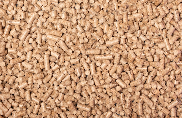 Texture of woody clumps, pellets of litter, for cat, rabbit, guinea pig, hamster, rodent, bird, turtle and other pets. cat litter for a toilet close-up. cat tray wooden