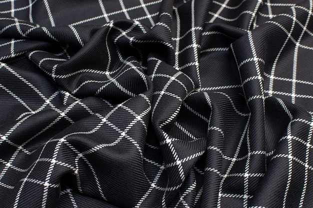 The texture of the woolen fabric in the cell is black and white.