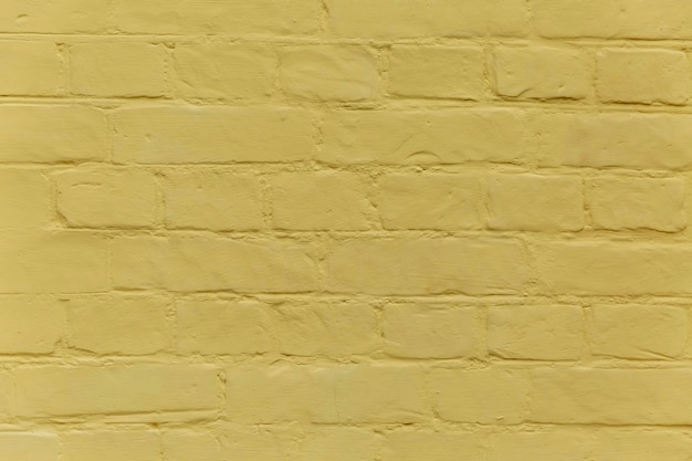 Texture of a yellow brick wall. background. space for text.
