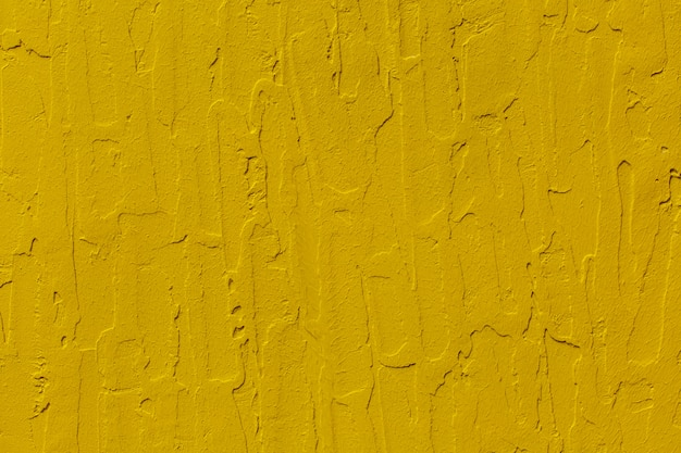 Texture of yellow concrete wall background