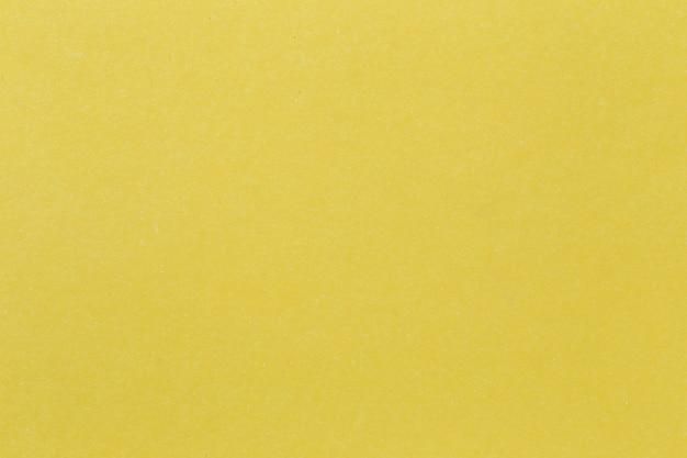 Texture of yellow paper cardboard art.
