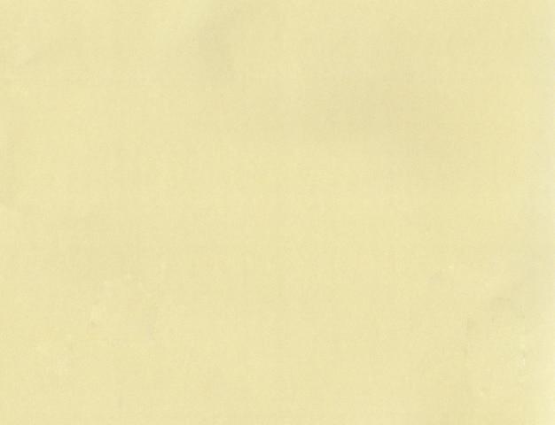 背景のテクスチャ黄色い紙。