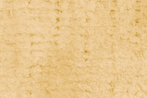 Texture of yellow plaster. rough wall of the building.