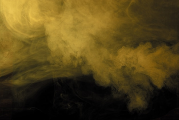 Texture of yellow smoke on a black background