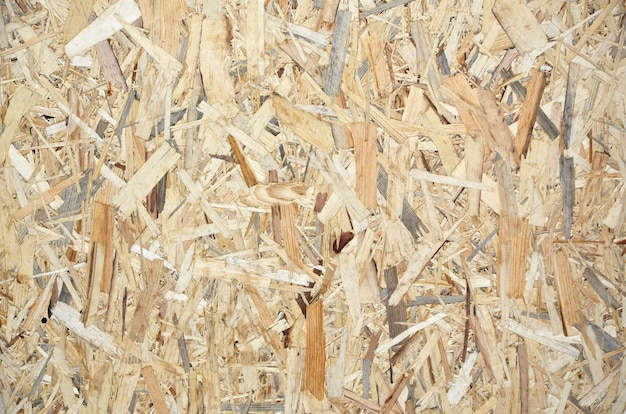 Texture of yellow wooden osb plate close up