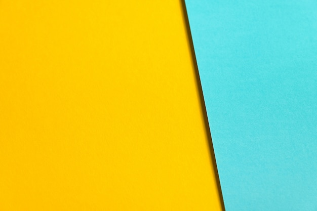 Textured background of blue and yellow colored paper.