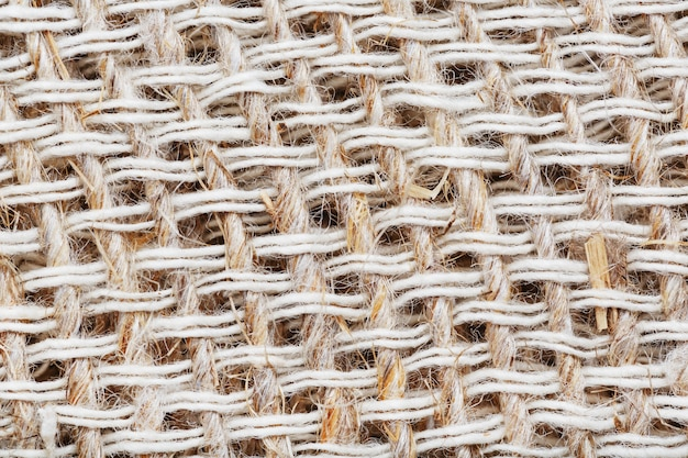 Textured background of fabric from burlap fibers with fibers in full screen. macro