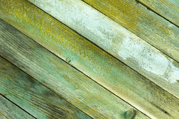 Textured background from old painted boards placed diagonally, grunge style. copyspace