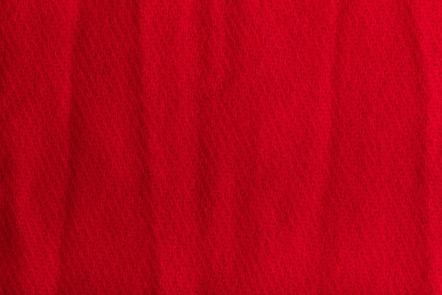 Textured background from red woolen fabric. crumpled surface.