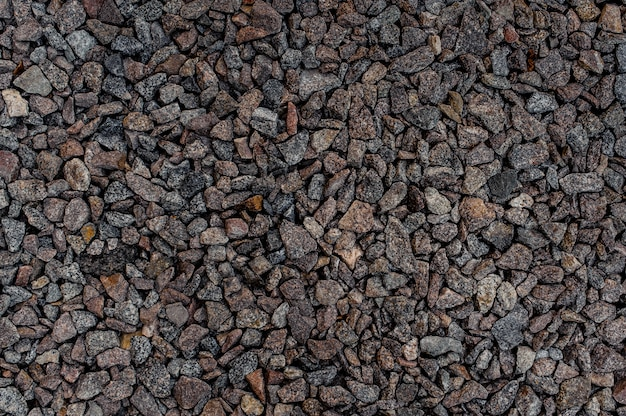 Textured background wallpaper of grey sharp pebbles stones