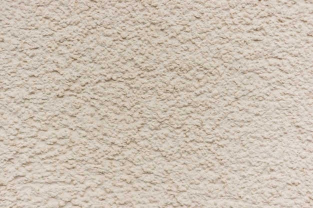 Textured beige wall background