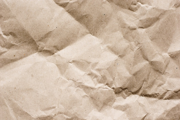 Textured brown craft paper close-up background copy space
