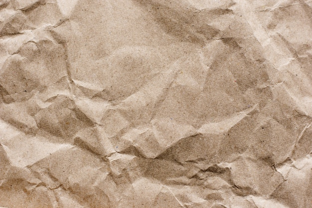 Textured brown craft paper close-up background