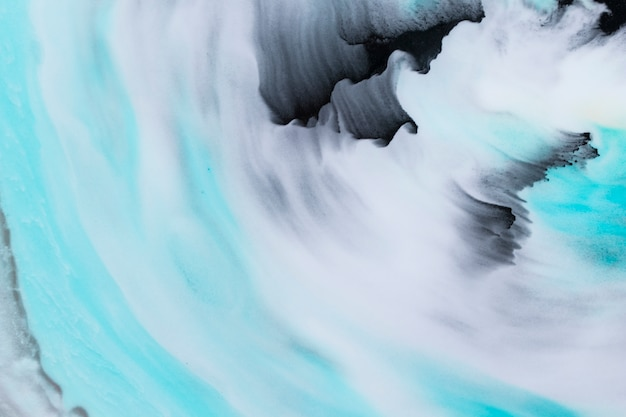 Textured brush strokes in black and turquoise color over background
