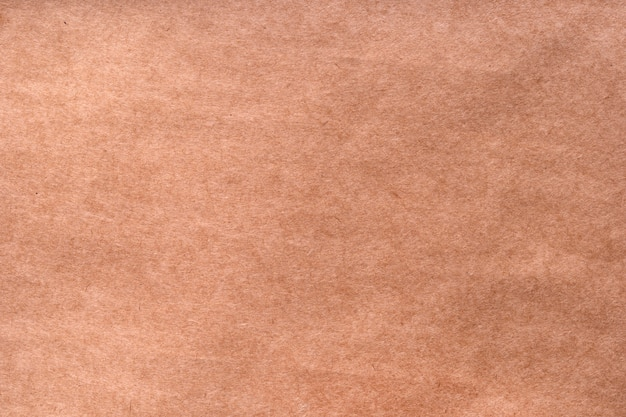 Textured craft surface brown paper sheet or cardboard surface