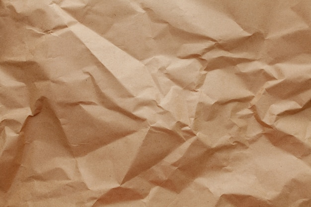 Textured crumpled packaging a brown paper background.