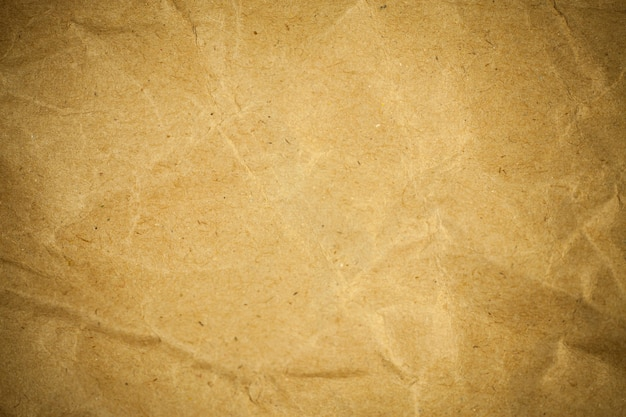 Textured crumpled packaging brown paper background.