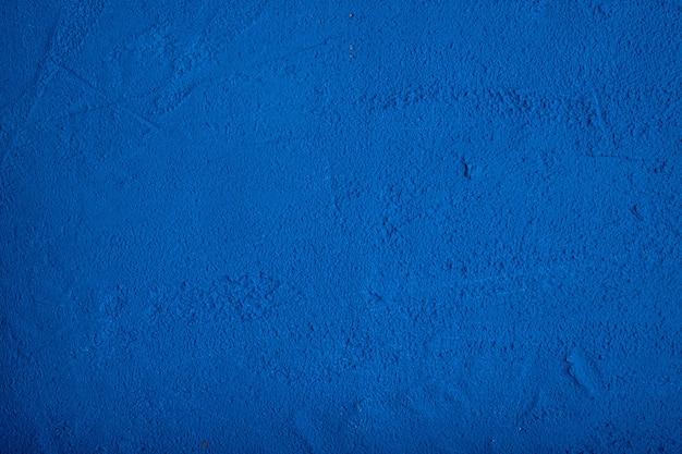 Textured embossed dark blue background