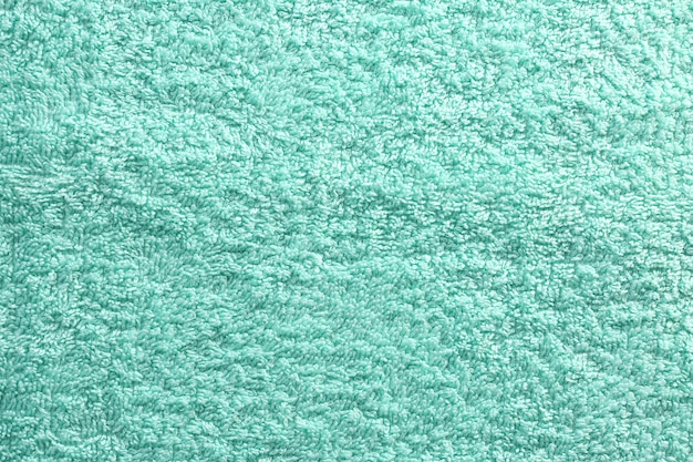 Textured fabric background in mint color