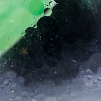 Textured green and black liquefy abstract background