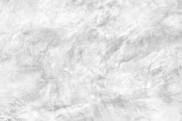 コンクリートの表面壁と白い背景のテクスチャ