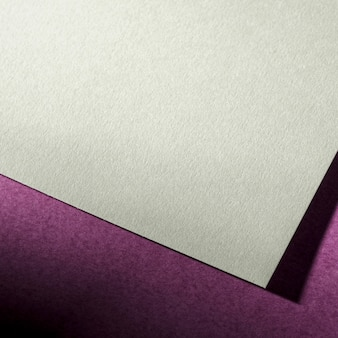 Textured paper on purple background