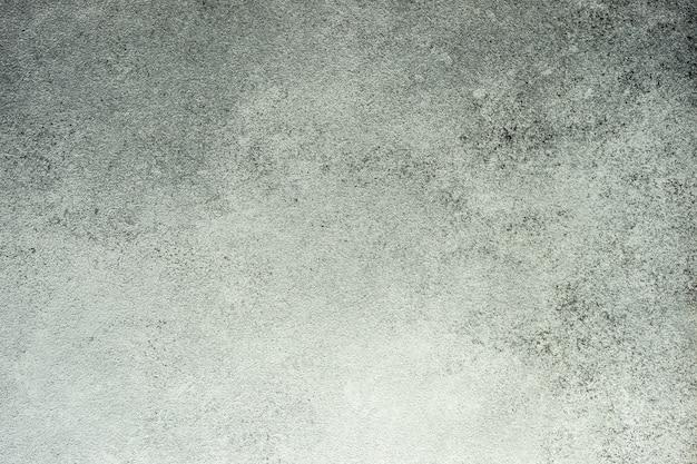 灰色の織り目加工の石またはコンクリートの背景