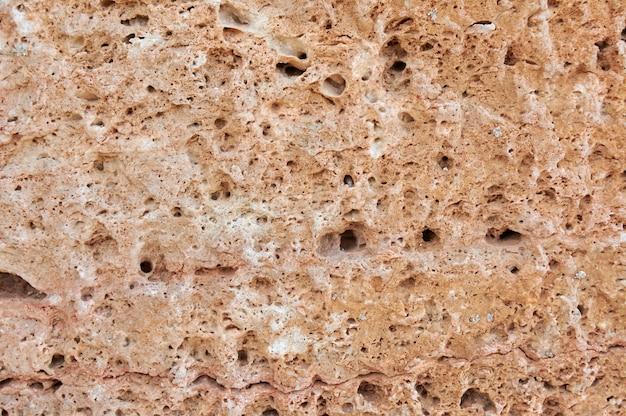 질감 돌, 사암, 석회암 표면. 이미지를 닫습니다. 돌, 배경에 대 한 자연 추상 질감입니다. 확대. 벽지, 건축.