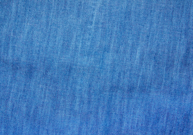 Textured striped blue denim fabric surface