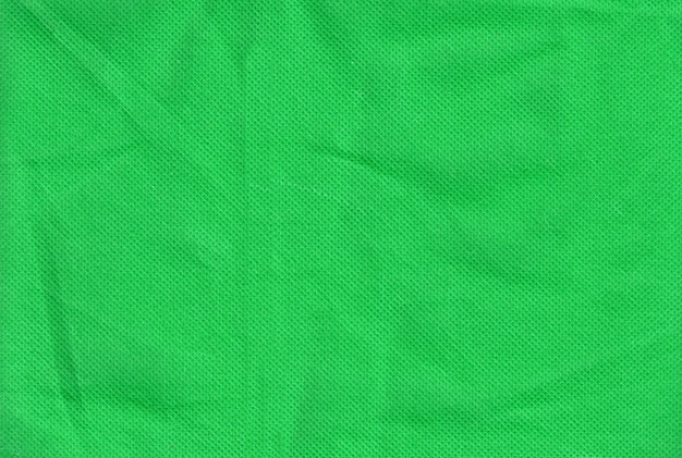 緑のしわくちゃのテキスタイルの織り目加工の表面