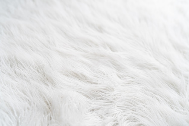Textured white background with hairy fur carpet, close-up. high quality photo