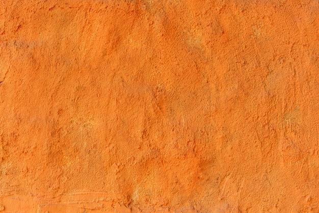텍스처와 오렌지 클레이 배경의 벽입니다.