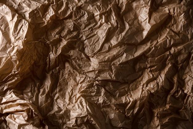 茶色の紙のテクスチャ、背景のしわくちゃの紙のリサイクル