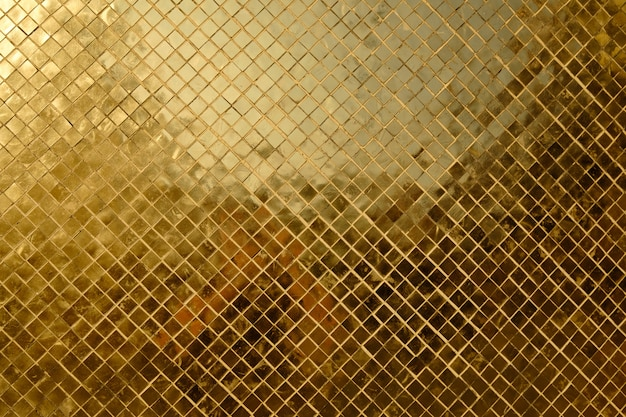 Texure of rich golden mosaic close up