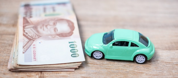 Thai baht banknote stack with car.