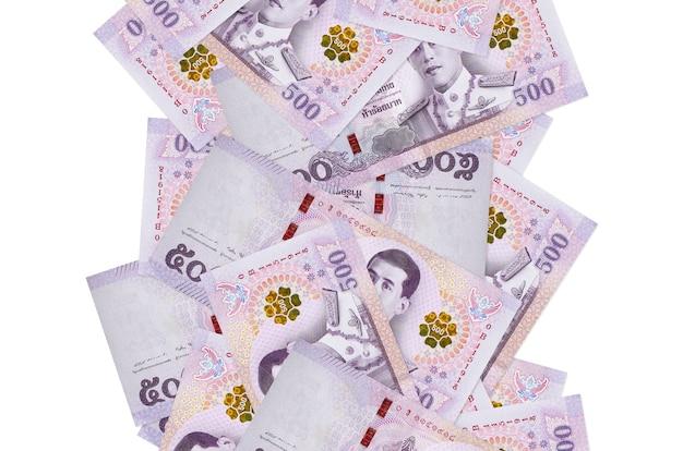 Thai baht bills flying down isolated on white