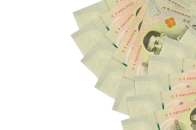 Thai baht bills laying on white surface
