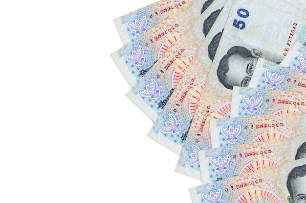 Thai baht bills lies isolated on white background