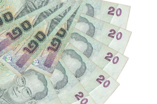 Thai baht bills lies isolated on white