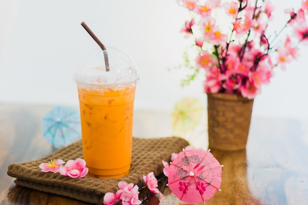 Thai beverage,milk thai tea on table