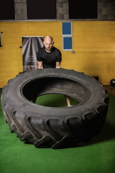 Thai boxer lifting heavy tyre